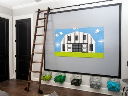 The boys' bedroom features a LEGO wall complete with metal baskets and a library ladder on rollers for those hard-to-reach spots.