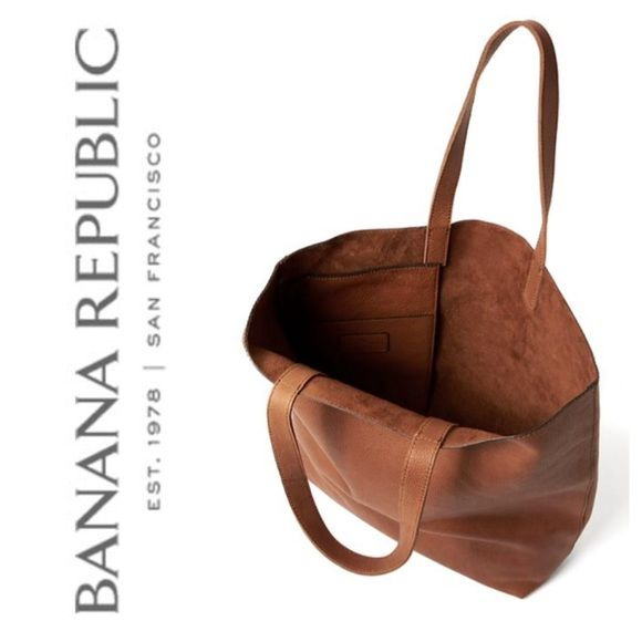 "HP 2/24  Banana Republic Cognac Leather Tote Banana Republic's Side Zip Leather Tote is similar to Madewell's Transport Tote, but the straps are 1"" wide for comfort and they're stitched for durability. There's an exterior zip pocket and an interior slip pocket. The leather is incredible soft and the interior is a beautiful suede. About 16"" top to bottom, 5"" wide, 14"" across at the bottom, and 19"" across the top when flat. This leather is amazing quality and made to last.  ❌ I do not trade…"