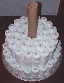 Diaper Cake Instructions   cool before adding diapers tie these diapers snuggly around your tube ...