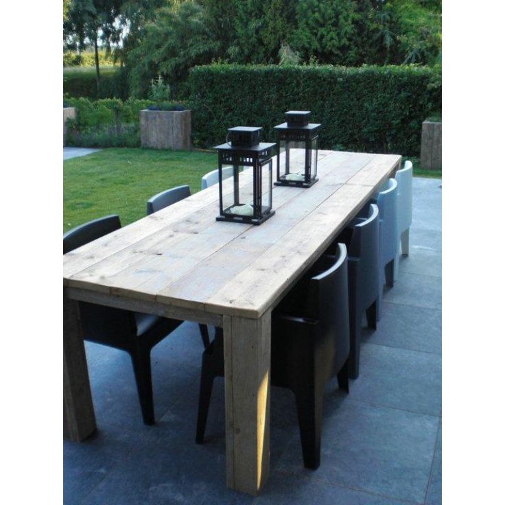lanterns, farmhouse patio table and contemporary chairs