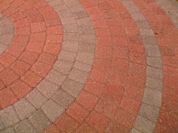 Using a special concrete paver pack and the advice of DIYNetwork.com experts, laying an attractive circular patio has never been easier.