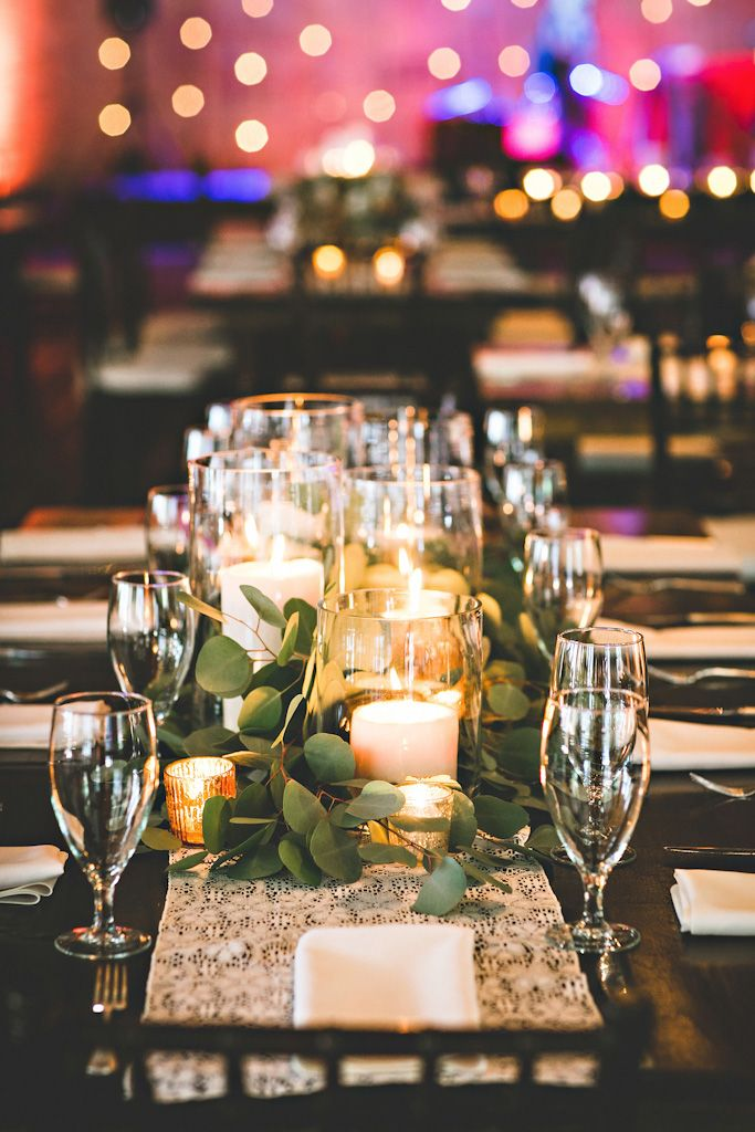 Centerpieces candles greenery hitched flowers
