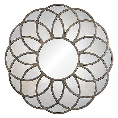 With a pattern both floral and geometric, this piece is sure to complement a wide variety of spaces. Made out of metal with an antique silver leaf finish with antiqued mirrors in the frame.