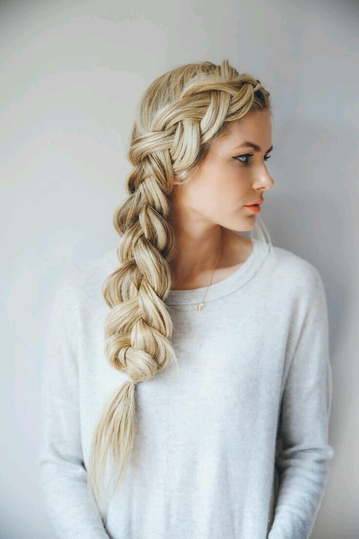 Girl with a voluminous and long side braid