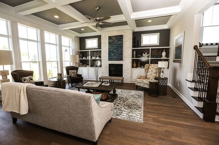 Great Room in JV Model Home #great #room #jerome #village #model #home #windows #coffered #ceiling #fireplace #mantel #built #ins #bead #board #hardwood #flooring #interior #design #staging #luxury #custom #3 #pillar #homes #plain #city #ohio #dublin #schools #dream #real #estate #builder #stone #sherwin #williams #stair #staircase #built #on #site #railing #post #double #window #carpeted #stairs #window #bench