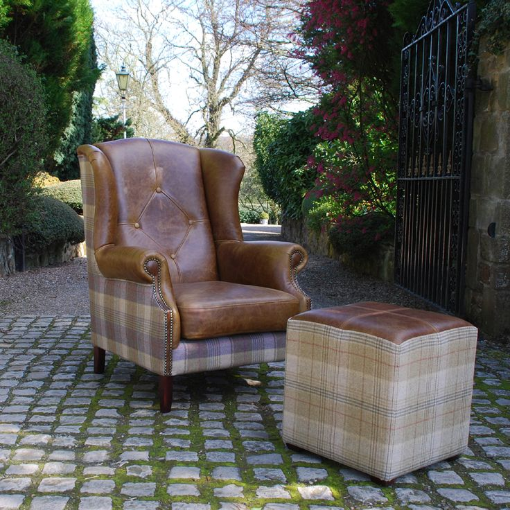 Julius Armchair & Caesar Cube Footstool from Curiosity Interiors, made with leather & wool fabrics in a tartan, tweed pattern.