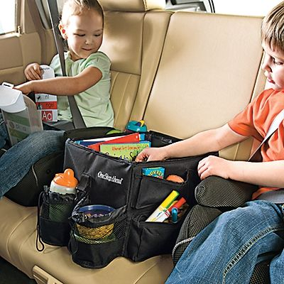 Kids Backseat Travel Toy Organizer by onestepahead: Corral the mess and keep peace. Big enough for two to share, this roomy organizer anchors in place with a seatbelt, has adjustable dividers, 2 drink holders, eight outside pockets and a carrying strap as well as a sturdy lid which doubles as a play or snack tray.  #Kids #Car_Travel_Organizer