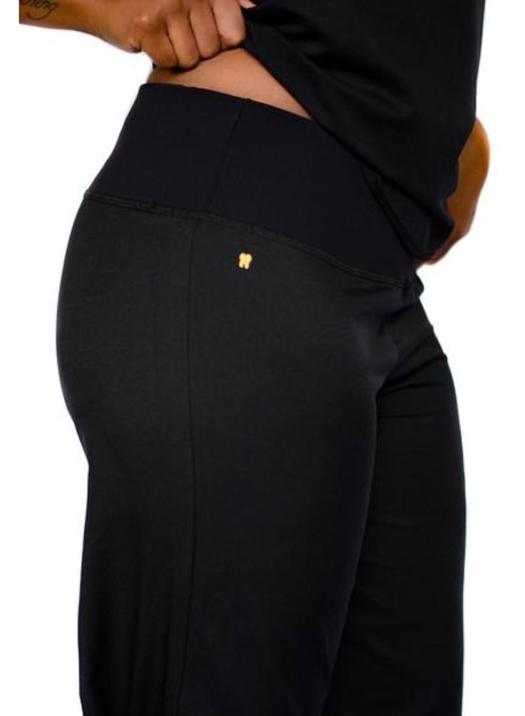 move over, little black dress! here comes DHN's little black scrub. soft and semi-fitted with a yoga band but no pockets or slits. also decorated with a gold tooth. material is water-wicking and stain resistant.  * DHN scrubs are created for dental professionals, by dental professionals