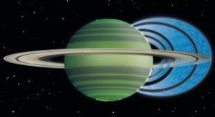 """La imagen que se ve junto a este texto ilustra un curioso fenómeno. Los discos azules concéntricos que parten de los anillos de Saturno y caen en el propio gigante gaseosos son partículas de agua con carga eléctrica. Esta """"lluvia"""" espacial provoca una reducción en el brillo atmosférico de Saturno"""