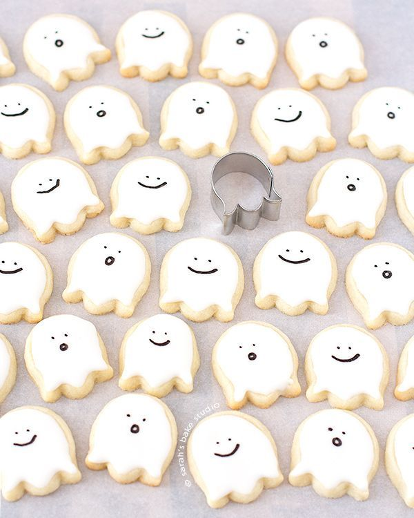 Happy Little Ghost Sugar Cookies – bite-sized, deliciously cute, Halloween decorated sugar cookies that scream sweetness with their happy ghoulish faces.
