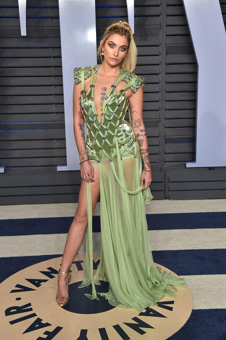 Paris Jackson looked like Tinker Bell at the Vanity Fair Oscars Party. Click above to see why her dress was also a tribute to her father, Micheal Jackson!