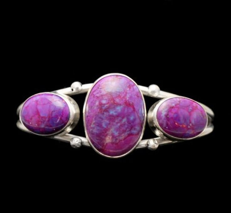 Triple Stone Magenta Turquoise Cuff Sterling silver cuff bracelet with 3 Magenta Turquoise oval stones set on a simple silver cuff http://nativeamericanstuff.net/magenta_turquoise_jewelry.htm