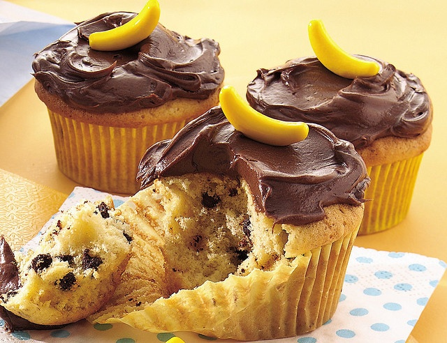 Banana Choc Chip cupcakes with Choc frosting: Cake mix, 2 bananas, some choc chips and frosting. Easy and Yum!