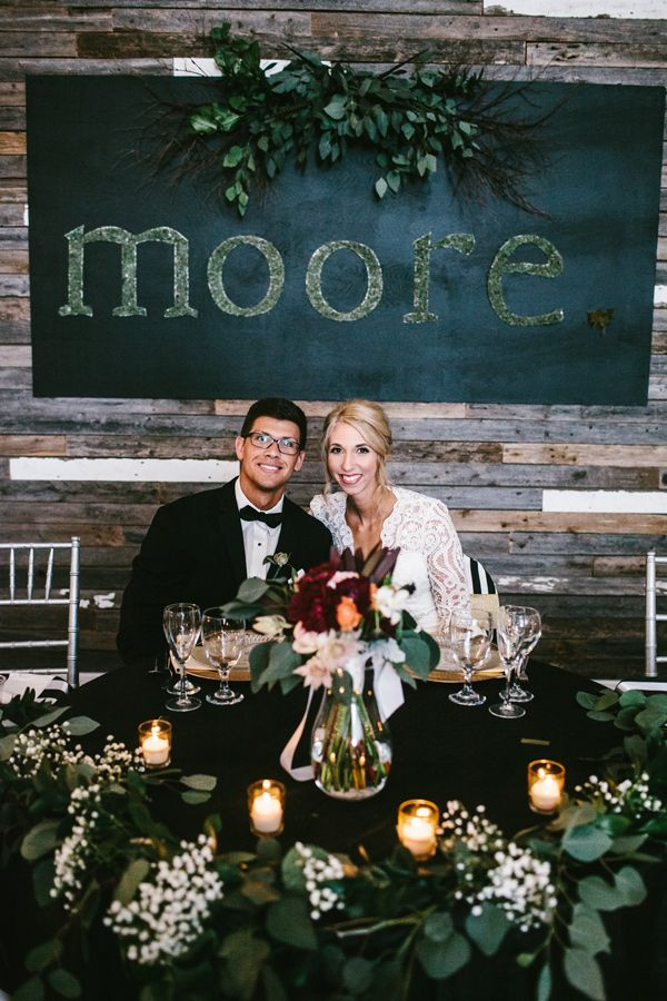 sweetheart table - photo by Sarah Libby Photography http://ruffledblog.com/modern-black-and-white-wedding-with-emerald