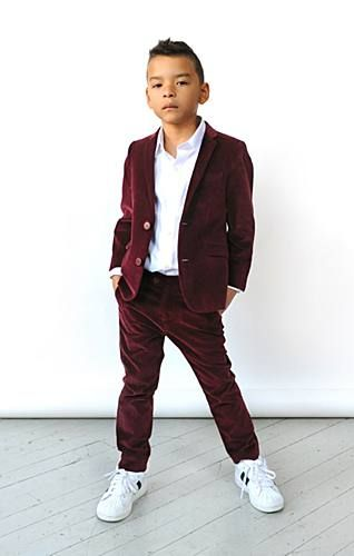 Omg If there is a kid alive who could rock a maroon velvet suit I think we know who...