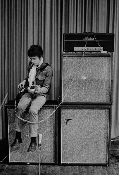 Jack BRUCE and CREAM; Jack Bruce sitting on amplifiers, onstage, during soundcheckIn February of 1967, Cream embarked on a short tour of Germany. By March, they had moved on to Denmark and Sweden.  (Photo by Jan Persson/Redferns)