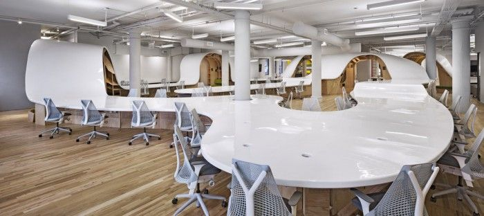 The Barbarian Group redesigned its New York office last year. It decided to get rid of all desks, except one - a 4,400-sq ft table with a price tag of $300,000. All 125 employees sit along the snaking desk. It provides 5 feet of space per person.