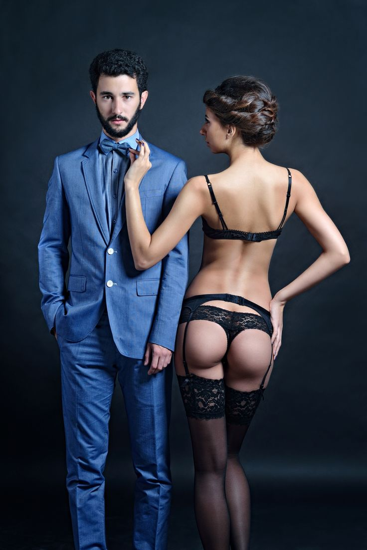 Beautiful couple IV - Beautiful girl in black lingerie with a man in a blue suit