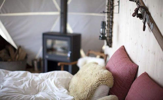 love the idea of sheepskin over the pillows!