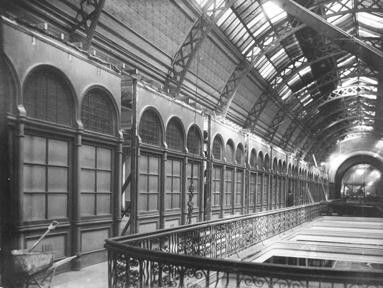 Queen Victoria Markets Building (QVB) in Sydney,alterations and additions in 1918.View along the top gallery level showing shop fronts and cast iron railings and barrel vaulted glass roof in 1918. •City of Sydney Archives•