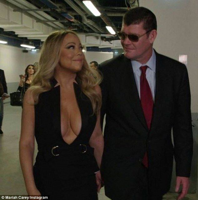 Bust-ing out! Mariah Carey showed off her generous chest in a fitted black dress on Saturday as she stepped out with her fiance James Packer