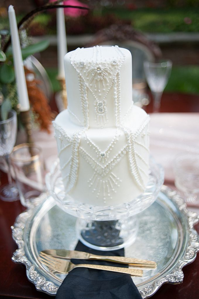 Beautiful white glammed cake. If you have a 1920s themed wedding, this cake is another great design to check out.