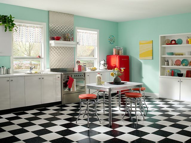 Looking for a way to add a fun twist to a traditional 50's style kitchen? Adding a splash of color to the walls, paired with the iconic black and white checked tile flooring can help achieve a timeless, colorful, and bright kitchen!  Featured Behr Paint Colors: Walls: Balmy Seas 490C-3 Ceiling: Ultra Pure White 1850 Trim: Ultra Pure White 1850 Accents: Lemon Pound Cake 320B-4 Poinsettia 150B-7