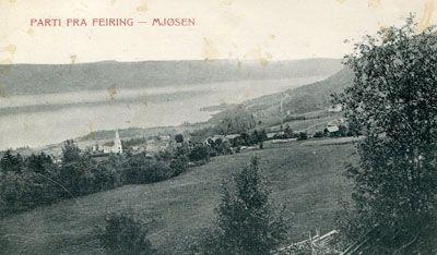 Akershus fylke, Eidsvoll kommune MJØSEN -Mjøsa Parti fra Feiring. Oversiktsbilde. Kirken nede t.v. Brukt 1914