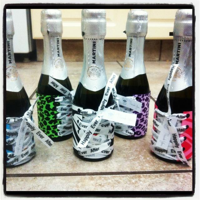 Lingerie bridal shower favors,, corset champagne covers....