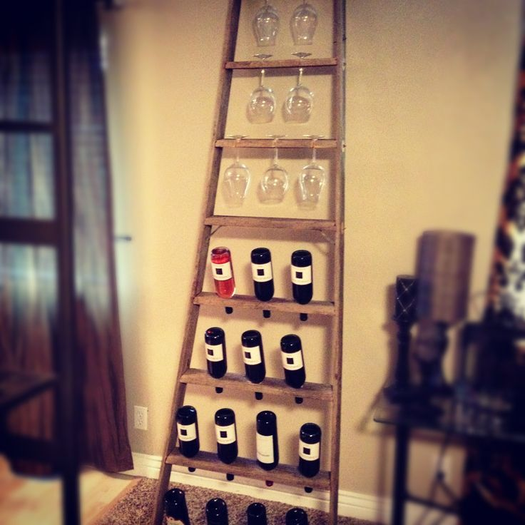 I've been looking at uniquely used items as wine racks and came across this gem. Nice alternative use of a ladder I would say.
