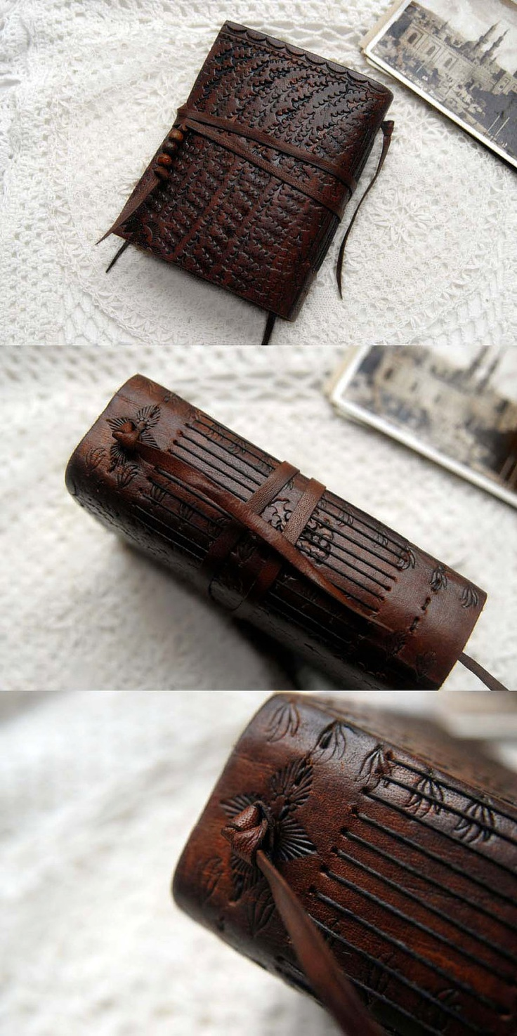 The Archivist - Vintage Tooled Leather Journal with Rustic Tea Stained Pages, Vintage Ink Stamps & Mixed Paper Ephemera. $145.00, via Etsy.