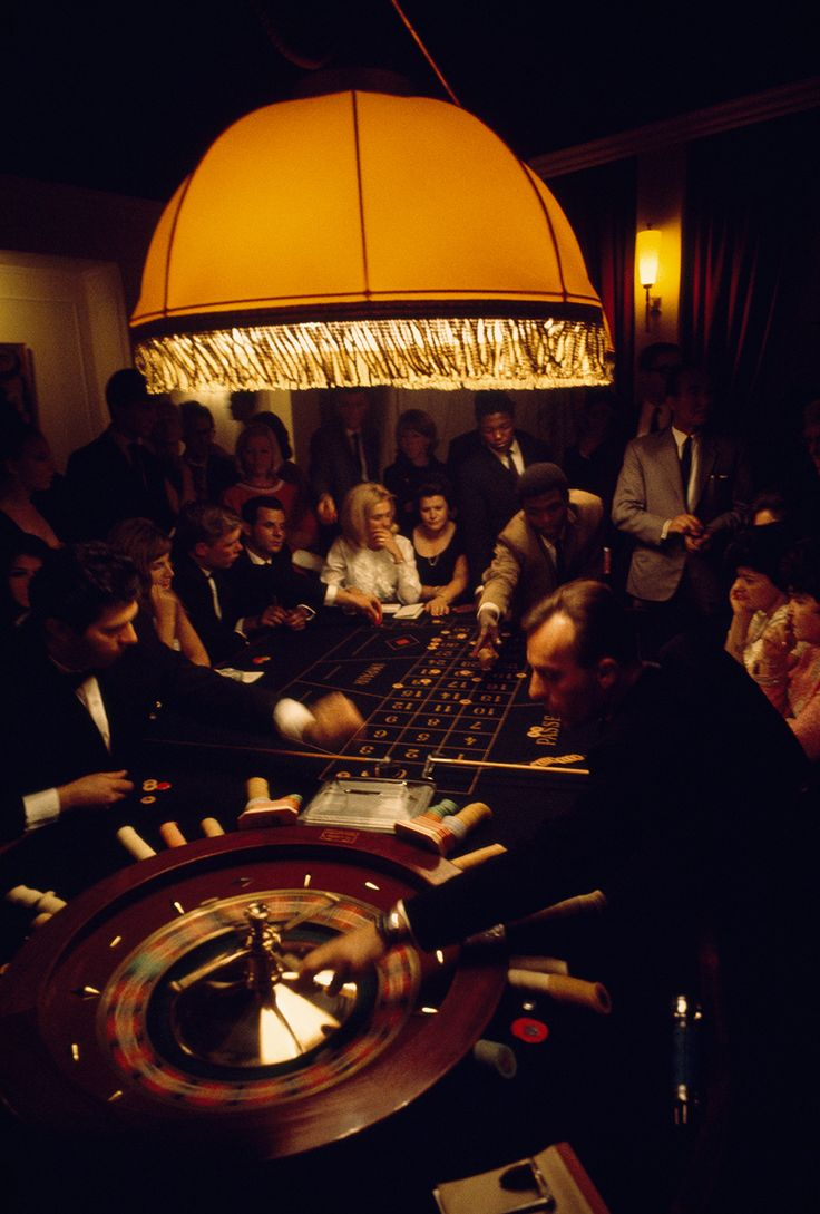 Visitors of diverse nationalities crowd a casino roulette table in Swaziland, 1969.Photograph by Volkmar K. Wentzel, National Geographic Creative