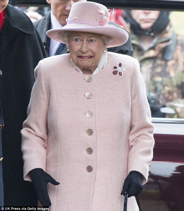 Frozen: The Queen grimaces as she arrives at church on the Sandringham estate yesterday, where temperatures were just above freezing