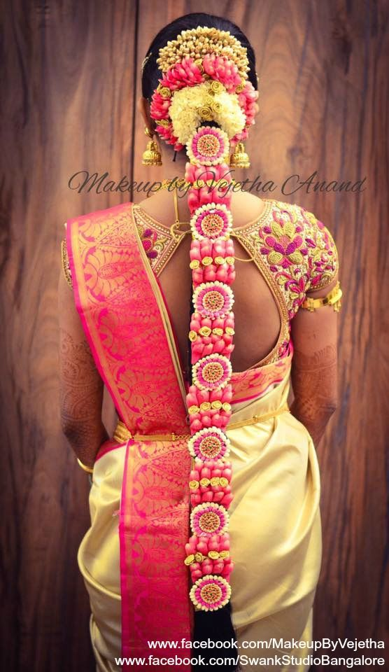 Traditional Southern Indian bride's bridal braid hair. Hairstyle by Vejetha for Swank Studio. Photo credit: Manish Ananda. Silk Saree. Sari Blouse Design. Hair Accessories. Temple jewelry. Jhumkis. Silk Kanjeevaram sari. Braid with fresh flowers. Tamil bride. Telugu bride. Kannada bride. Hindu bride. Malayalee bride. Find us at https://www.facebook.com/SwankStudioBangalore
