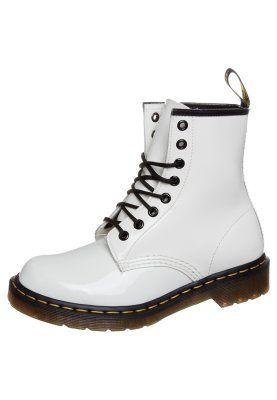 white dr. martens with black laces