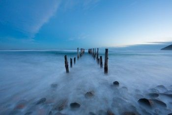 Swirling water around the poles at St Clair Beach, Dunedin, New Zealand. - Buy this print | Box of Light - Surf + Lifestyle + Mountains
