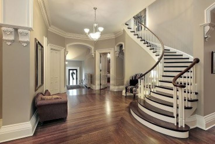 Foyer in traditional suburban home with curved staircase Stock Photo