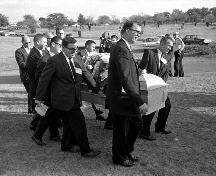 This file photo shows reporters that were enlisted to act as pall bearers at the interment of Lee Ha... - Gene Gordon/AP Photo