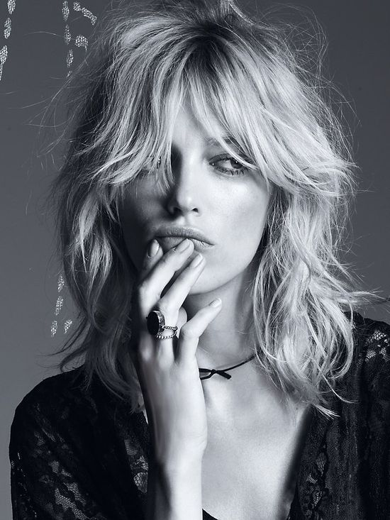 A middle parted grown out fringe and bed head waves - to achieve this try tonging large sections before you go to bed: