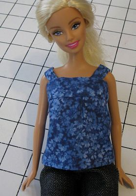 This free sewing pattern will create a simple top for a Barbie or similar fashion doll. The simple unfitted style teaches sewing skills while creating Barbie clothes. Use your scraps of fabric and this free printable sewing pattern to create a doll wardrobe.