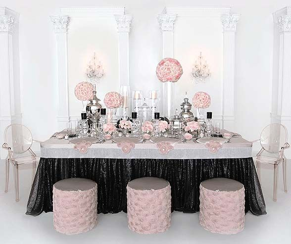 Candlelight Satin fitted cap with large Rhinestone border, Black Sequin Tulle tablecloth and Blush Rosette tulle ottomans.