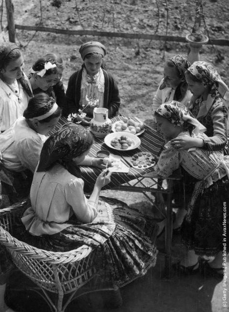 tolna county,hungary,circa 1950,girls,painting,easter eggs