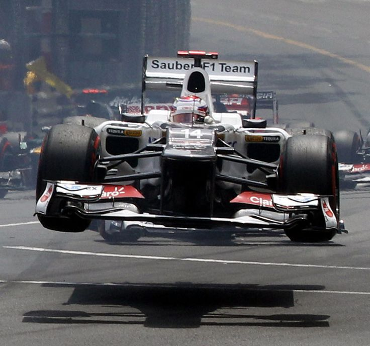 Japanese Formula One driver Kamui Kobayashi of Sauber goes airborne following a collision during the start of the 2012 Monaco Formula One Grand Prix at the Monte Carlo.