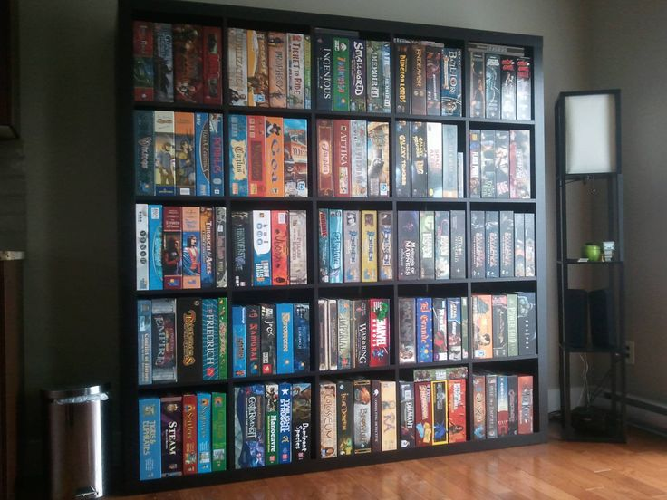 Boardgames displayed like books... I don't know why this never occurred to me! Would keep the boxes from collapsing under each other over time too