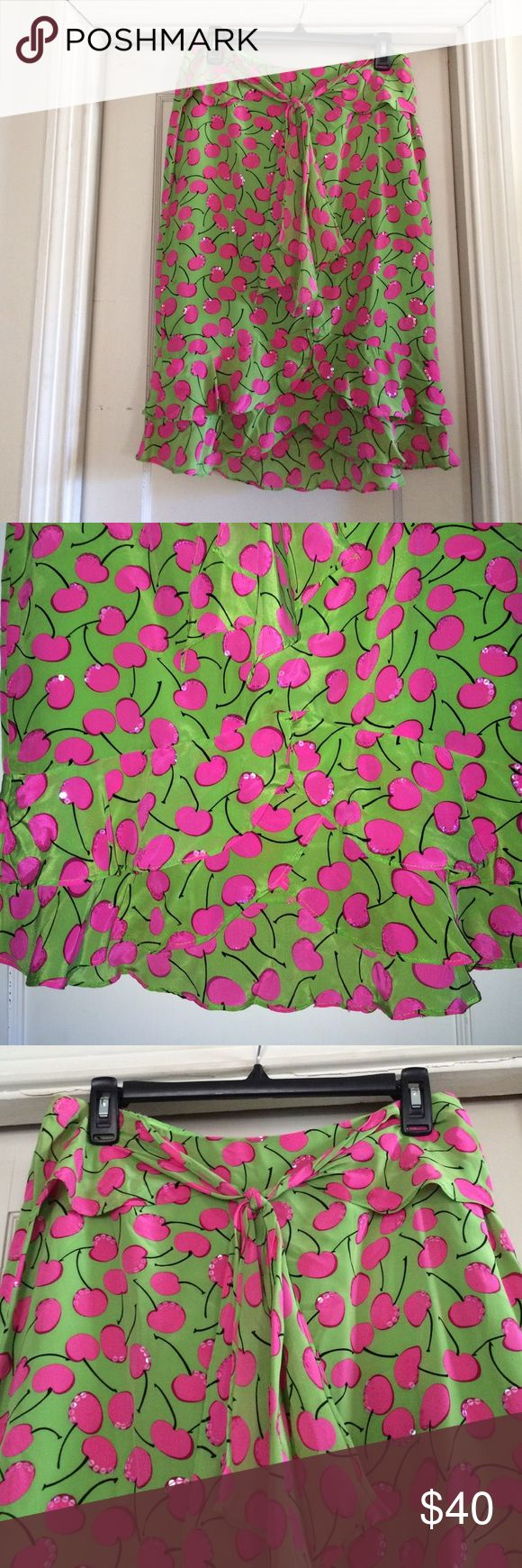 Nanette Lepore cherry design skirt.  Size 4. Nanette Lepore skirt.  Sz 4.  Florescent green with hot pink cherries.  Accented with clear sequins to give it a beautiful shimmer.  Zip back, straight style with ruffle him and tulip effect in front.  Faux sarong tie at front waist. Nanette Lepore Skirts