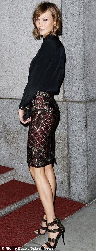 Keeping up with the times: Karlie Kloss chose a very autumnal look in a shirt tucked into an embellished skirt