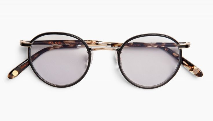 Want Les Essentials and Garrett Leight California Optical collaboration round wire/acetate frame in black with oil-and-vinegar acetate temples.