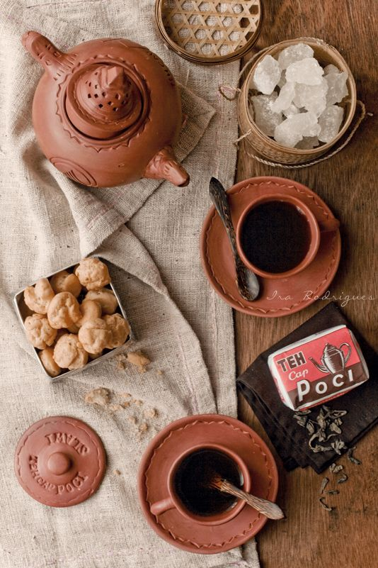 Teh Poci ~ brewed tea in the typical tea pot (poci) which is made of clay and sweeten by adding rock sugar.  Teh poci is well-liked by people specificly from central java and its originally from Slawi *Tegal and its become very famous drinking tea traditions | By Ira Rodriguez
