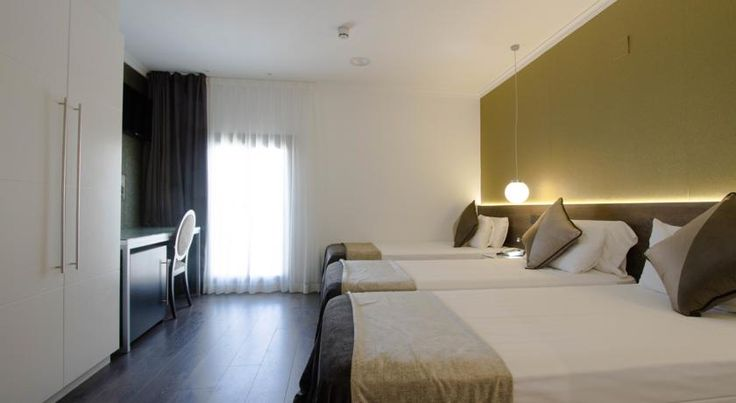 Moderno Barcelona Hotel Moderno has a central location, on a side street just 20 metres from Barcelona's famous Las Ramblas. It offers free breakfast and free Wi-Fi access throughout.  All rooms at the Moderno are heated, air conditioned and soundproofed.