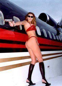 Trump's wife posing with gun...Thong and Boots..And they had a problem with Michelle's bare arms.